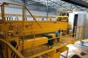 Изготовлены и смонтированы:станция управления,с применением частотных преобразователей Schneider Electric,модулей рекуперации и контроллеров Siemens.Также изготовлена кабина мостового крана,с использованием кресла оператора КПО-6.